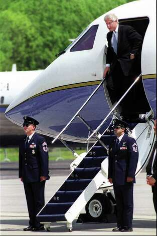 2000: President Bill Clinton departs his plane after landing at Westchester County Airport, NY, Wednesday afternoon.  Clinton spoke earlier in the day at the U.S. Coast Guard Academy Commencement ceremony in New London.   After landing at Westchester County Airport, Clinton played a round of golf at Stanwich Club in Greenwich. Photo: File Photo / Stamford Advocate File Photo