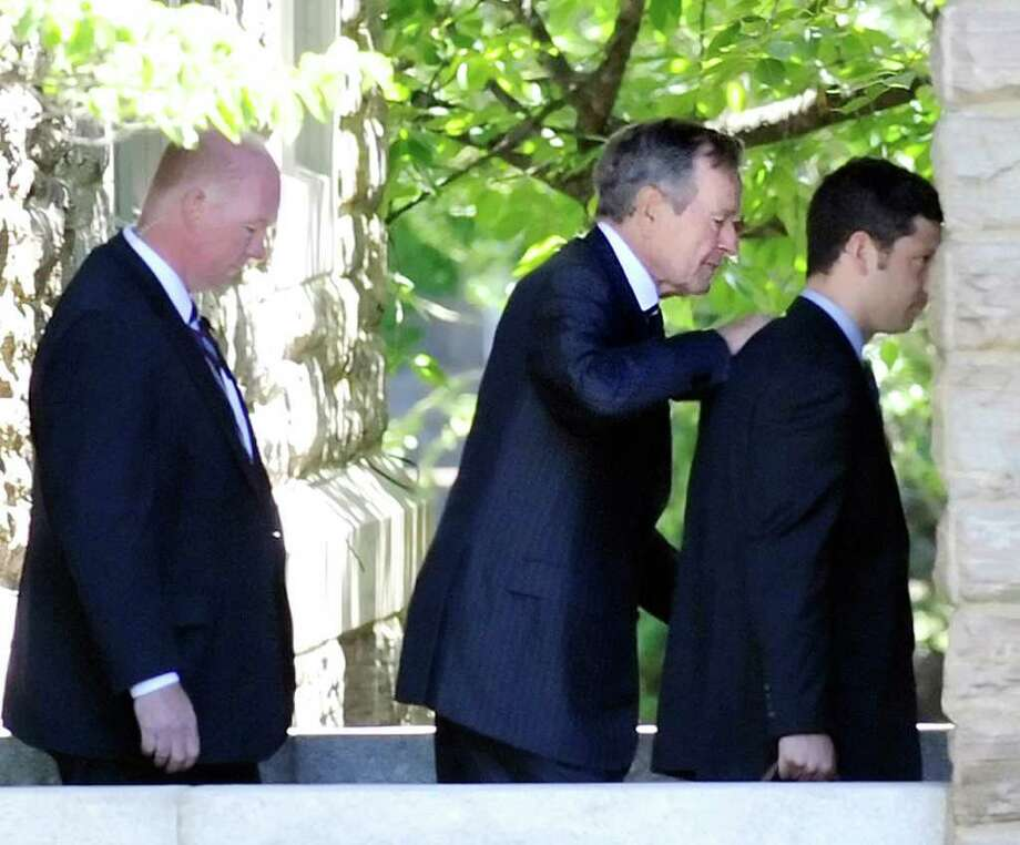 2010: Former President George H.W. Bush, center, leaves the memorial service for his brother Prescott Bush Jr., at Christ Church Greenwich, Wednesday afternoon June 30, 2010. Photo: File Photo / Stamford Advocate File Photo