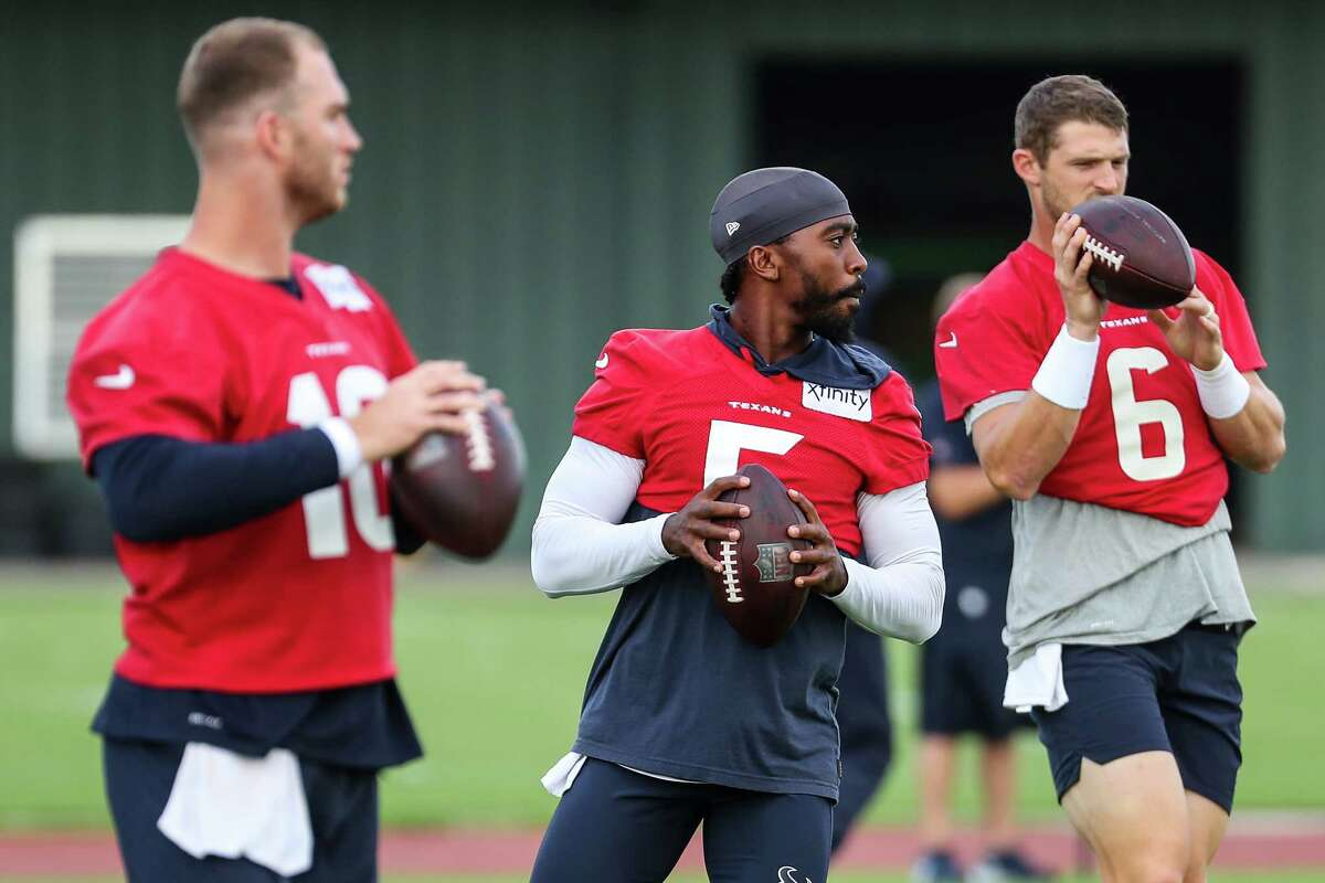 Houston Texans quarterbacks Davis Mills (10), Tyrod Taylor (5), and Jeff Driskel (6) warm up during an NFL training camp football practice Thursday, Aug. 19, 2021, in Houston.