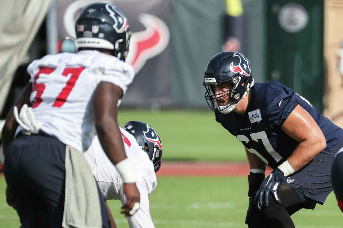 Houston Texans offensive tackle Charlie Heck (67) lines up against the Texans defense during an NFL training camp football practice Thursday, Aug. 19, 2021, in Houston.