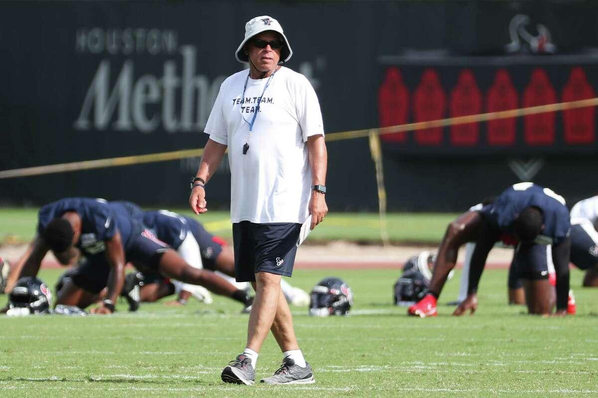 Houston Texans head coach David Culley walks across the field during an NFL training camp football practice Thursday, Aug. 19, 2021, in Houston.