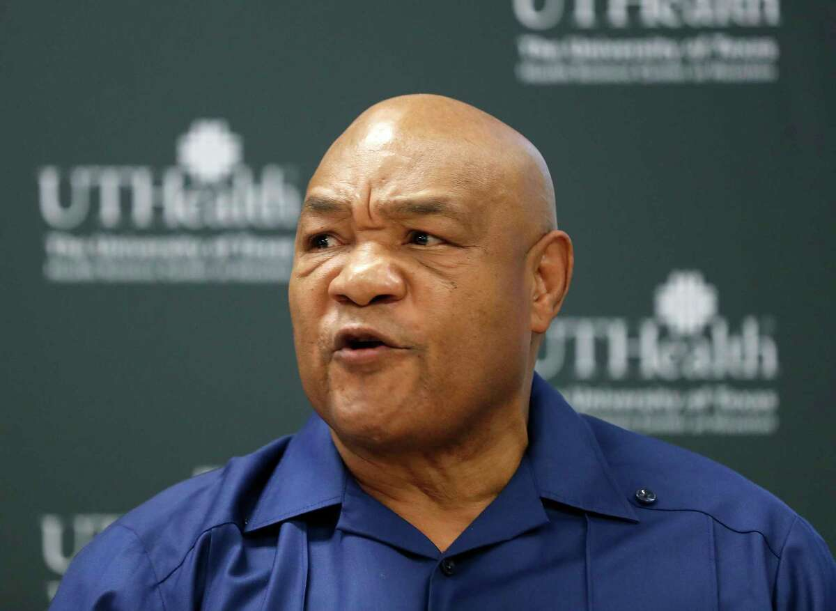 George Foreman speaks to the media after getting his first dose of the coronavirus vaccine at UT Physicians Multispecialty - Victory clinic, in Houston, Thursday, Jan. 14, 2021.