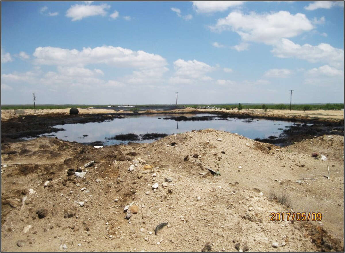After four years, the Railroad Commission has completed its $9 million clean up of the Wheeler Road Westex Notrees surface waste disposal facility near Odessa. One of the facility's open pits is shown before clean-up.