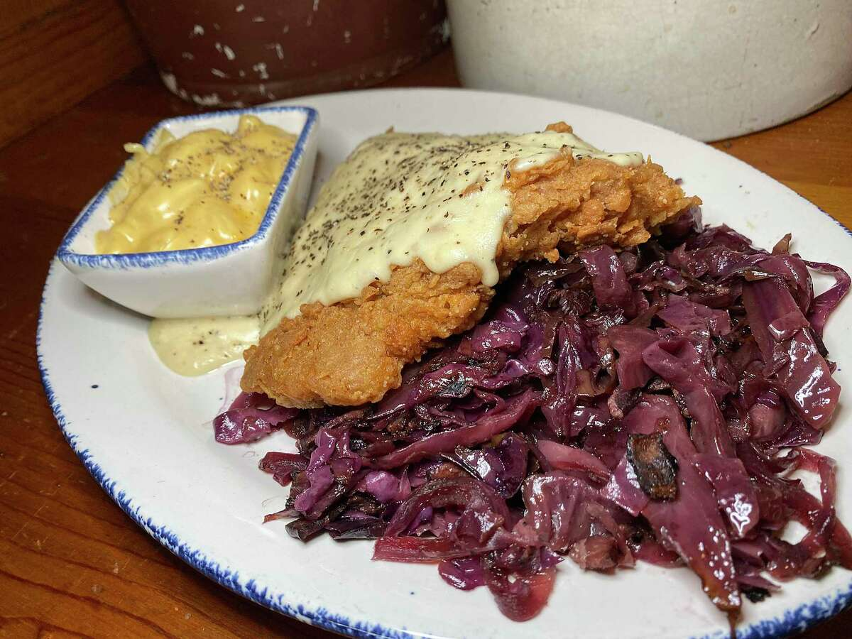 Chicken-fried steak comes with sides like macaroni and cheese and braised red cabbage at Mama's Cafe, a country cafe-style restaurant owned by the Lawton family on Nacogdoches Road outside Loop 410 on San Antonio's Northeast Side.