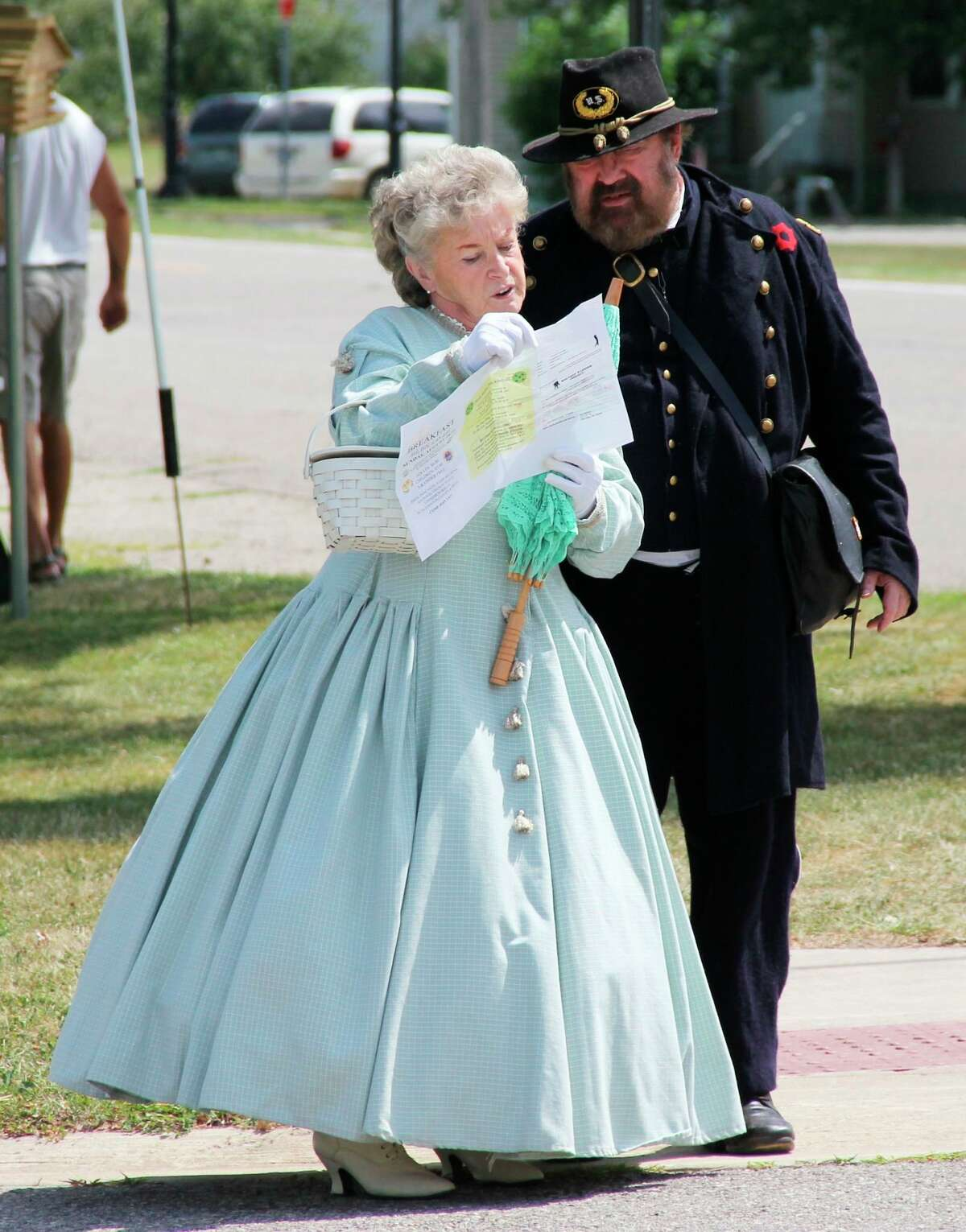 A couple in Civil War-era attire were spotted at ABC Day in Port Hope in 2019.The town's annual celebration of antiques, bean soup, crafts and collectibles returns Saturday, Aug. 21, after a two-year hiatus. (Tribune File Photo)