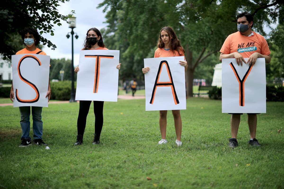 Activists demand that Congress and the Biden Administration create a path for citizenship for millions of immigrants while rallying in Lafayette Park across from the White House on August 17, 2021.(Photo by Chip Somodevilla/Getty Images)