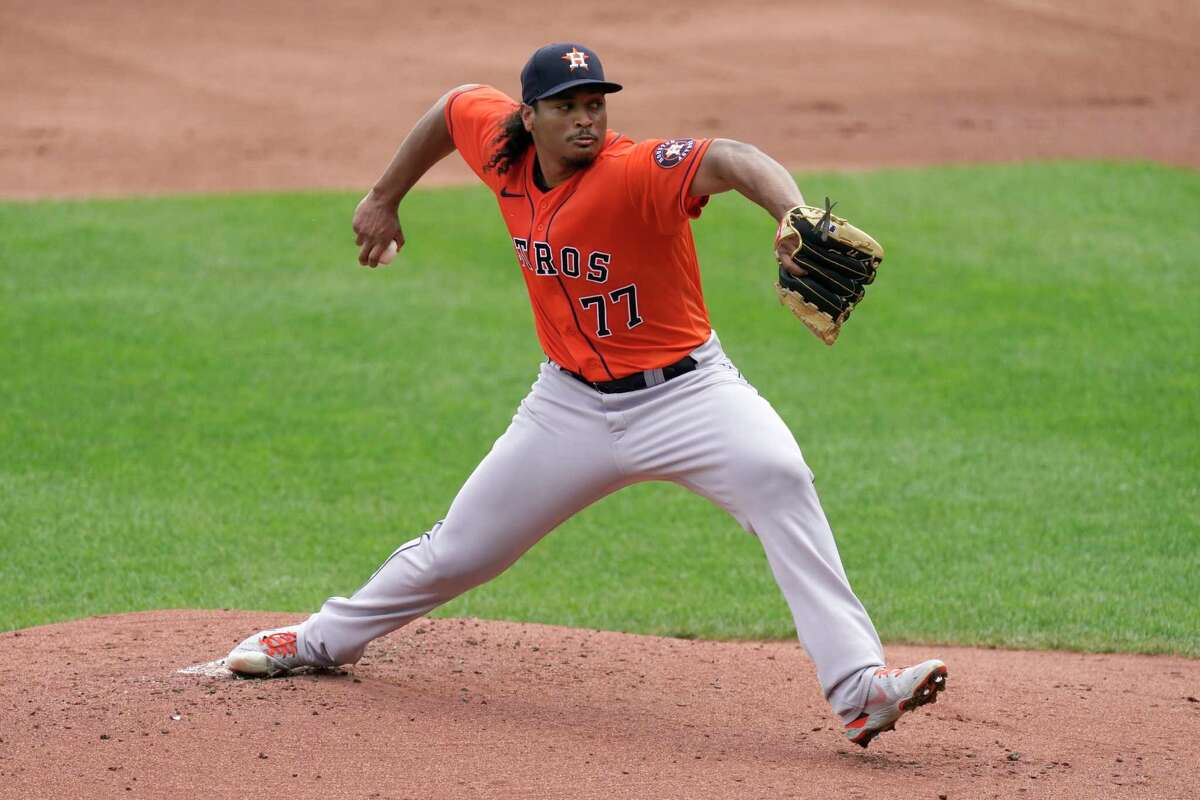 Houston Astros starting pitcher Luis Garcia throws during the first inning of a baseball game against the Kansas City Royals Thursday, Aug. 19, 2021, in Kansas City, Mo. (AP Photo/Charlie Riedel)