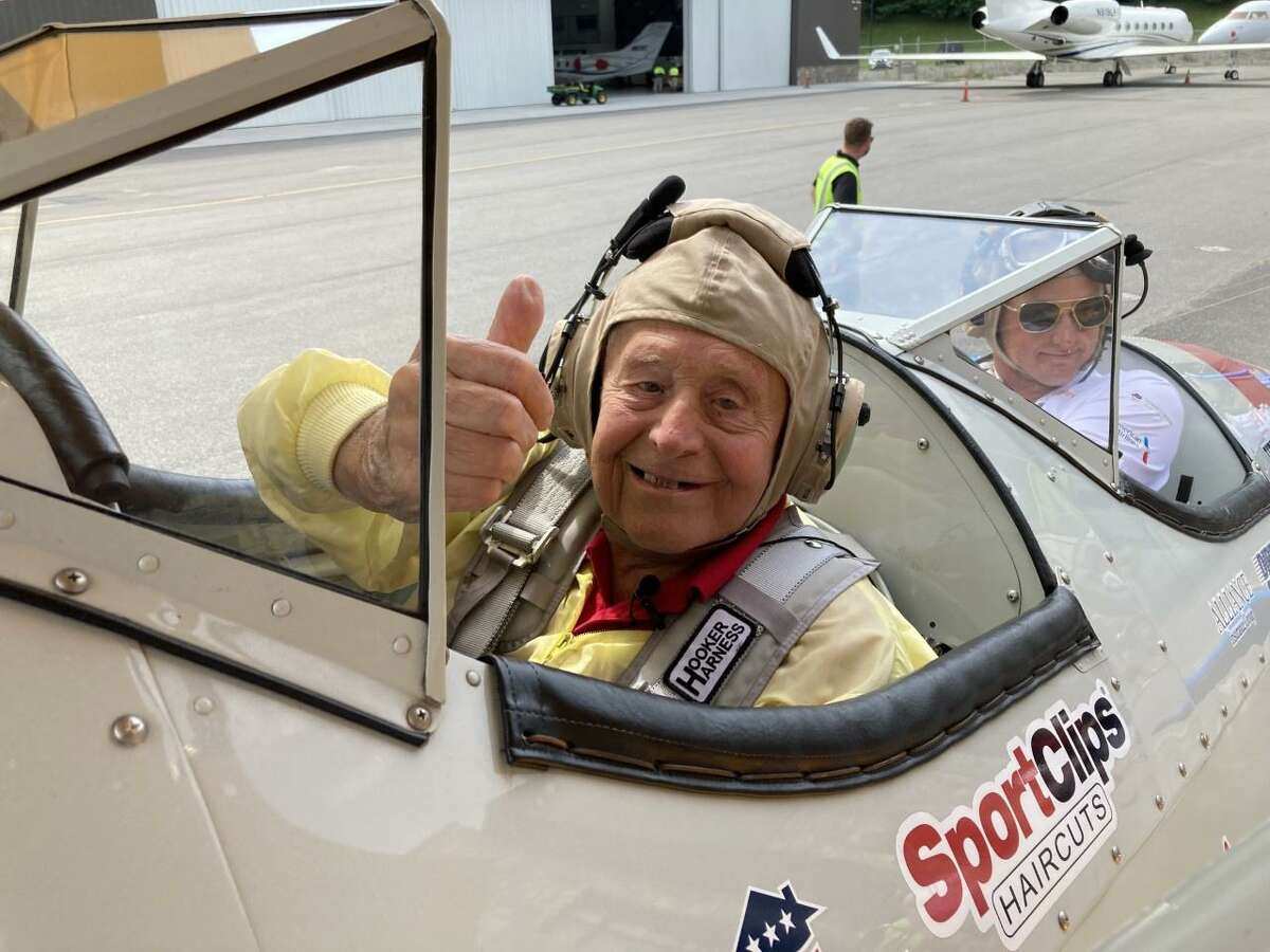 Darien resident Robert Mitchell, 95, in a restored vintage Boeing Stearman biplane at Westchester County Airport.