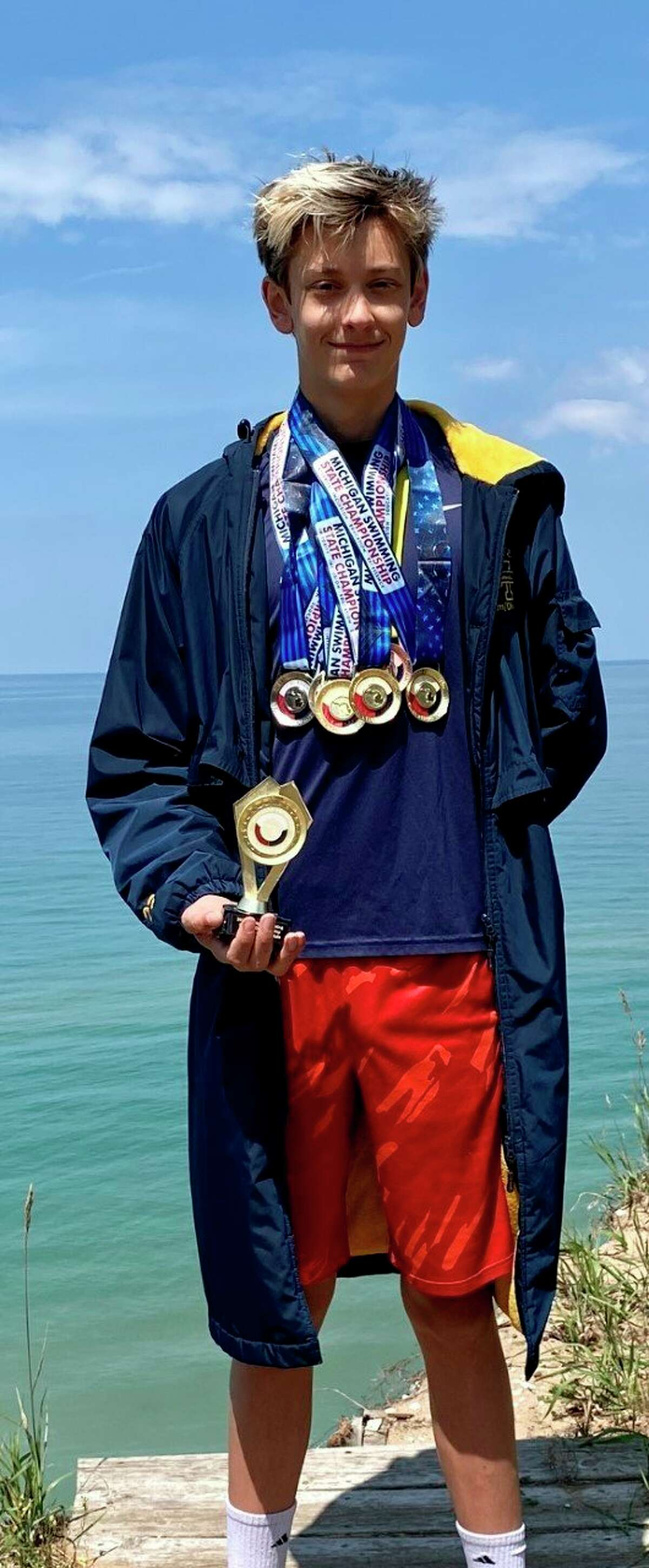Alex Lampen took home six medals and trophy after a dominant performance at the USA Swim Club State Meet in July. (Courtesy photo)
