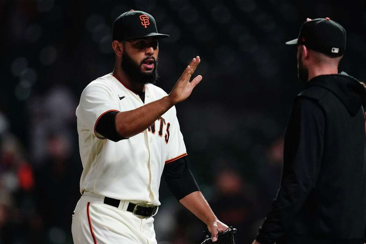 SAN FRANCISCO, CALIFORNIA - AUGUST 11: Jarlin Garcia #66 of the San Francisco Giants celebrates with teammates after defeating the Arizona Diamondbacks at Oracle Park on August 11, 2021 in San Francisco, California. (Photo by Ben Green/Getty Images)