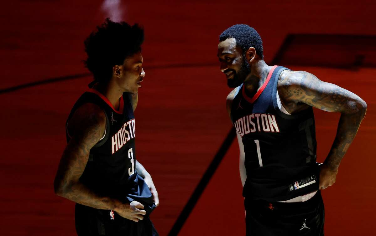 Kevin Porter Jr. #3 and John Wall #1 of the Houston Rockets talk prior to the game against the Miami Heat at American Airlines Arena on April 19, 2021 in Miami, Florida.
