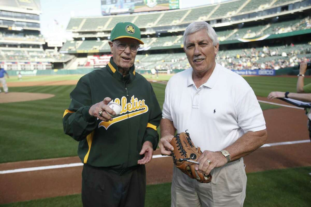 OAKLAND, CA - JULY 2: Monte Moore stands on the field with Broadcaster Ray Fosse of the Oakland Athletics prior to the game between the Athletics and the Minnesota Twins at the Oakland-Alameda County Coliseum on July 2, 2019 in Oakland, California. The Athletics defeated the Twins 8-6. (Photo by Michael Zagaris/Oakland Athletics/Getty Images)