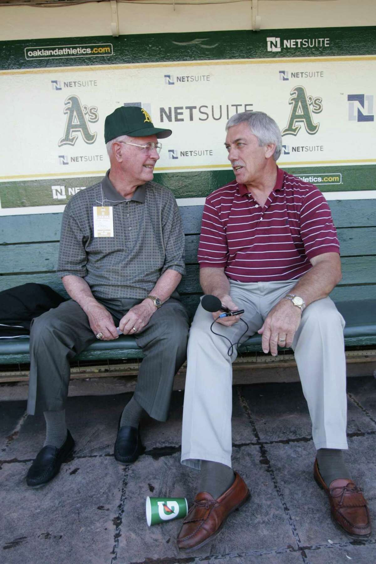 OAKLAND, CA - JUNE 23: Monte Moore and Ray Fosse in the dugout prior to the Oakland Athletics game against the San Francisco Giants at the Oakland Coliseum on June 23, 2009 in Oakland, California. The Giants defeated the Athletics 4-1. (Photo by Michael Zagaris/Getty Images)