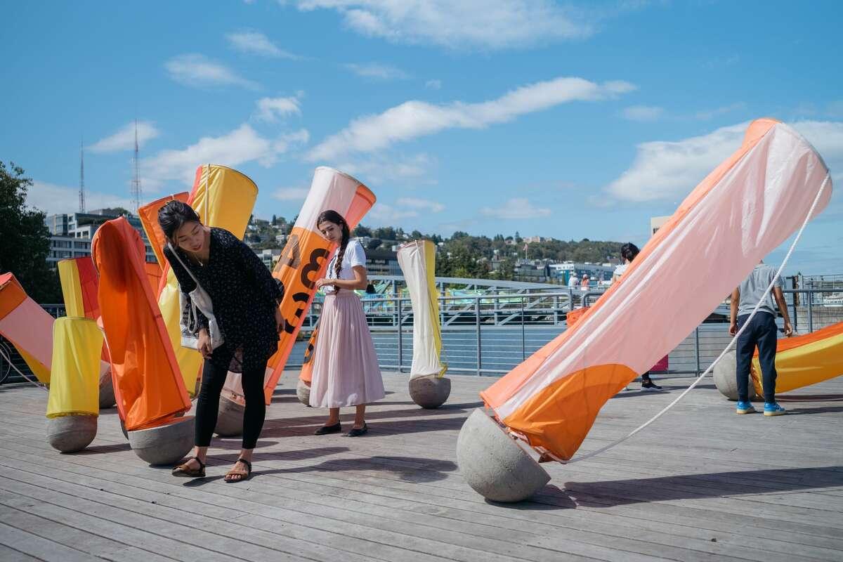 Visitors examine installations at Seattle Design Fest 2019.