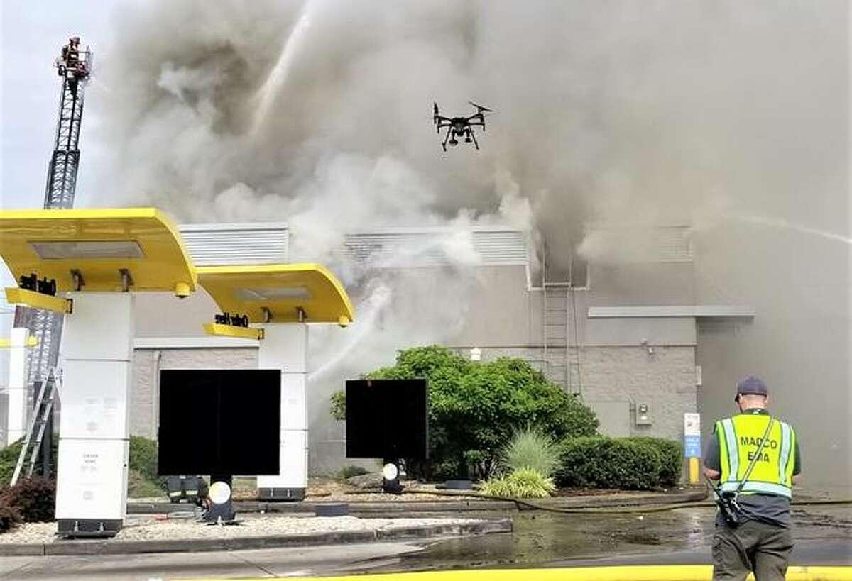 Capt. Matt Bogard flies the Madison County Emergency Management Agency drone during Broadway McDonald's fire June 17 in Alton.