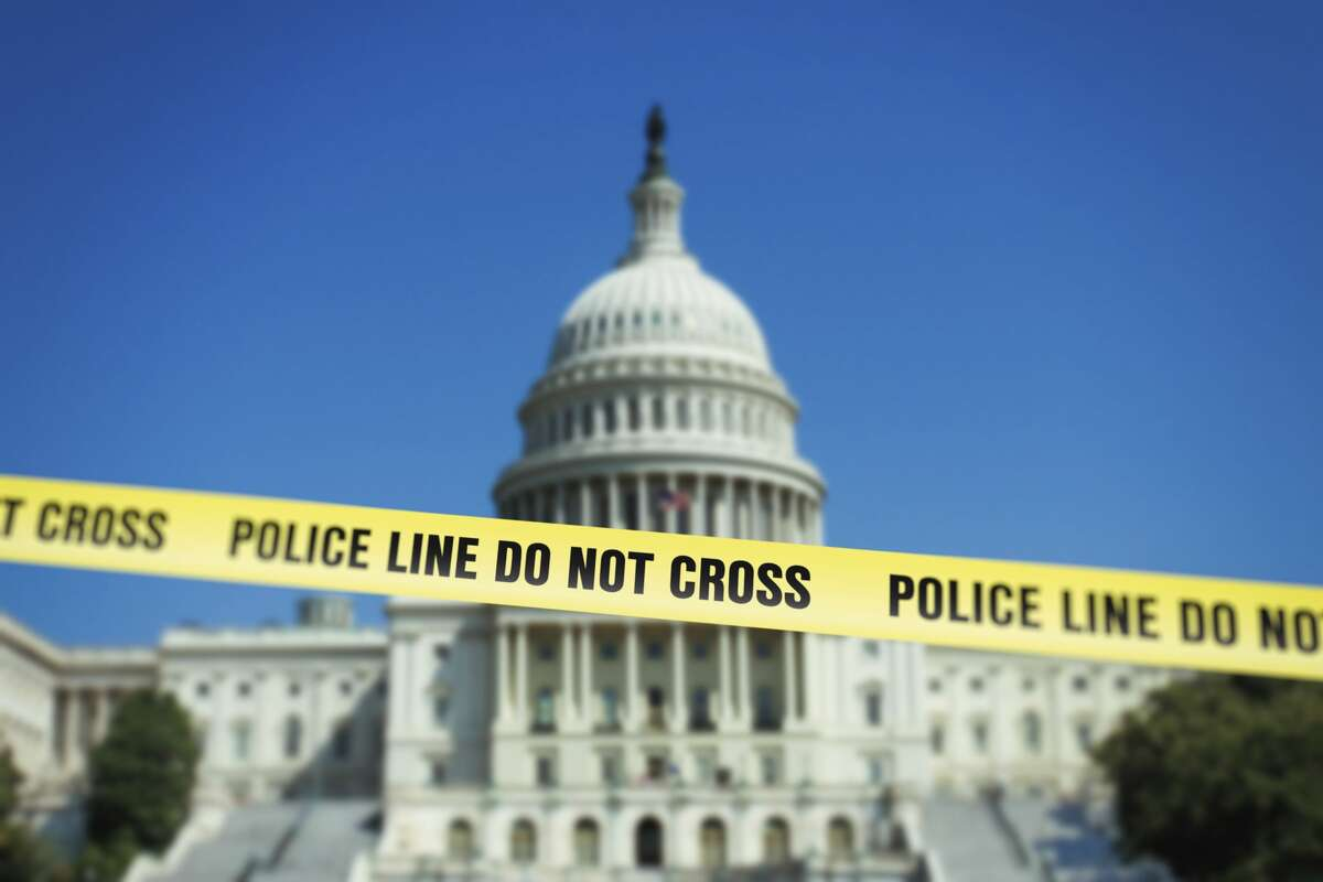 Capitol in Washington, D.C. with police fence tape.