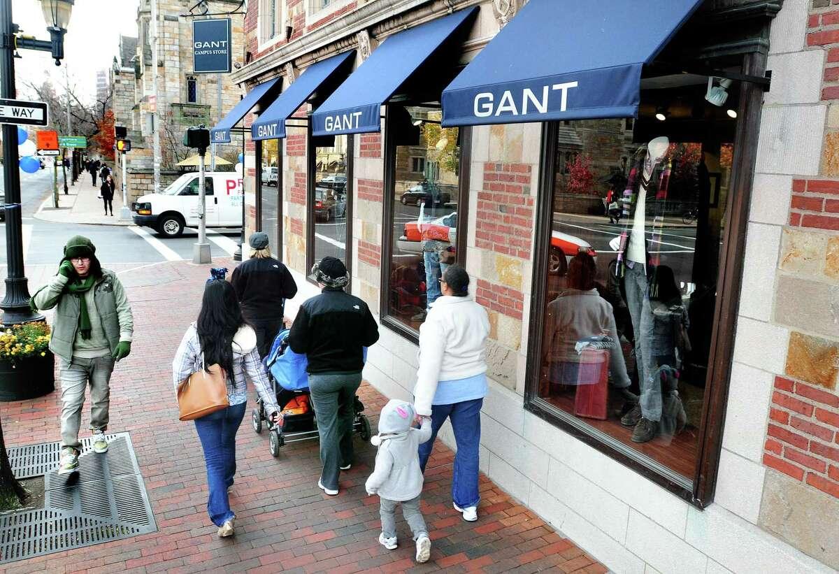 Pedestrians walk by the Gant Campus Store in New Haven in 2010.
