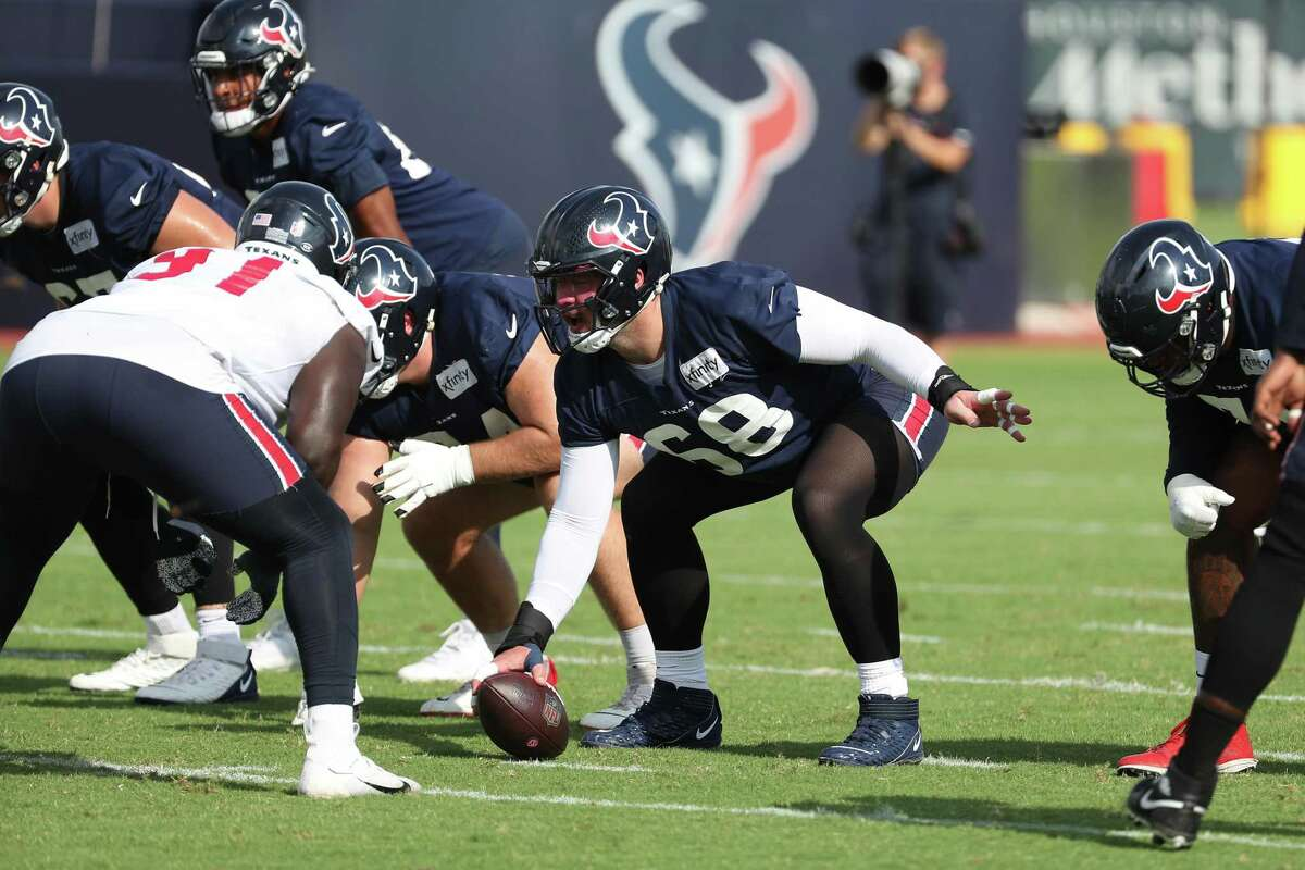 Houston Texans center Justin Britt (68) lines up against the Texans defense during an NFL training camp football practice Thursday, Aug. 19, 2021, in Houston.