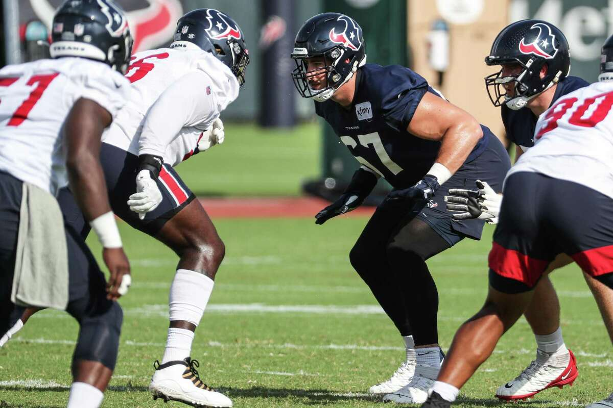 Houston Texans offensive tackle Charlie Heck (67) drops back to block defensive tackle Vincent Taylor (96) during an NFL training camp football practice Thursday, Aug. 19, 2021, in Houston.
