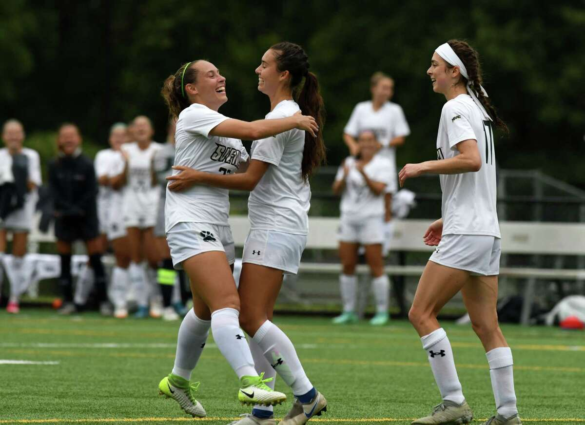 Lexi Bartlow, left, runs over to celebrate with Siena College teammate Katrina Kurtz, center, who had just scored a goal against Binghamton during the defending MAAC soccer champion?•s season opener on Thursday, Aug. 19, 2021, at Siena College in Colonie, N.Y.