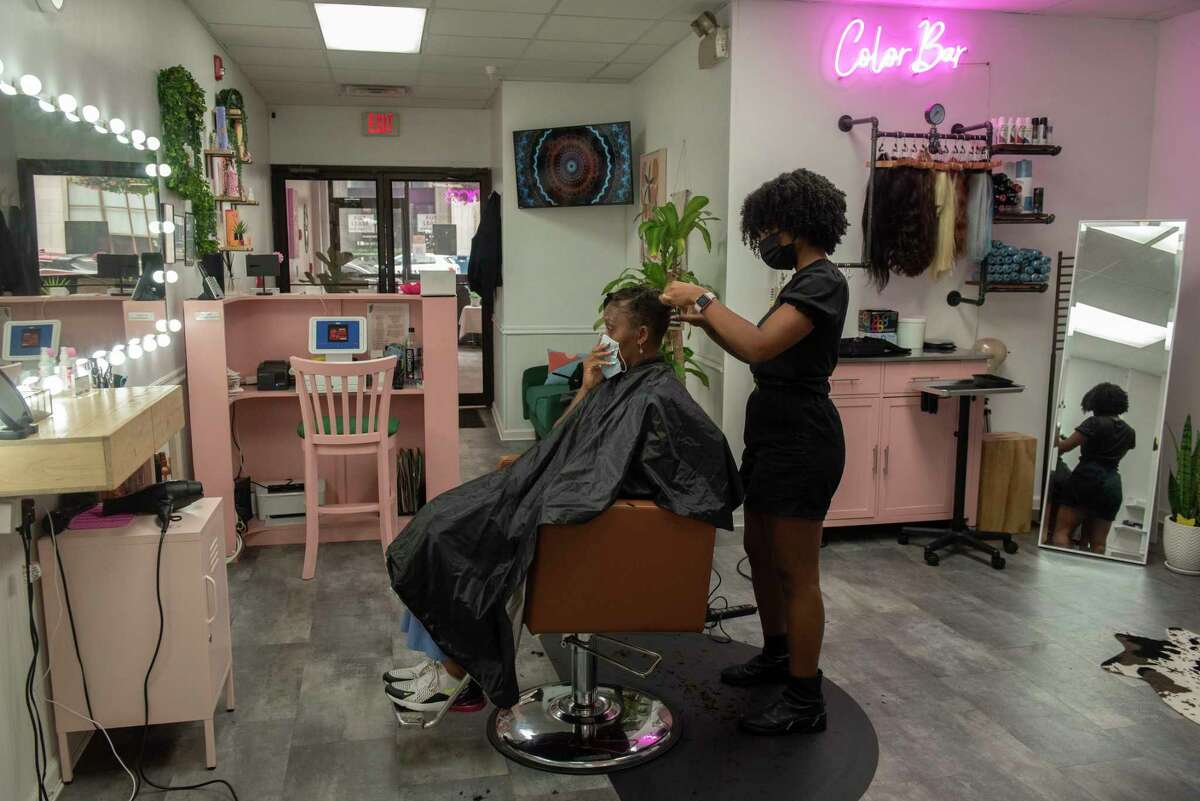 Crystal Mallett cuts the hair of her client Letricia Smith of Rensselaer at Studio 23 on Thursday, Aug. 19, 2021 in Albany, N.Y.