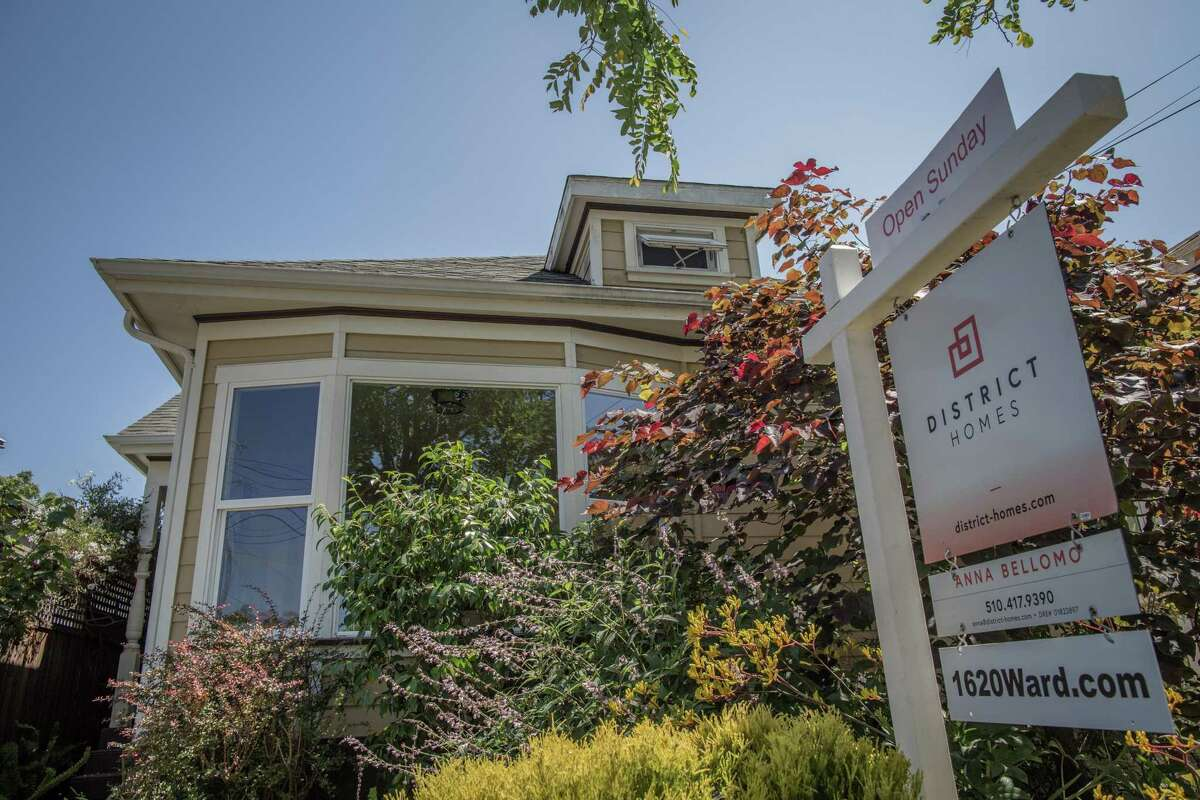 A for sale sign outside of a home in Berkeley. Bay Area home prices dipped slightly in July.