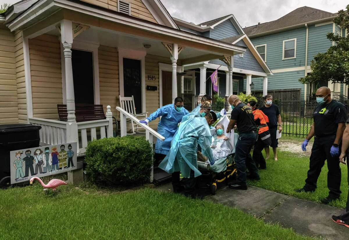 A woman, 95, who said she had tested positive for COVID-19 is transported to a hospital by Houston Fire Department EMS on August 15, 2021 in Houston, Texas.