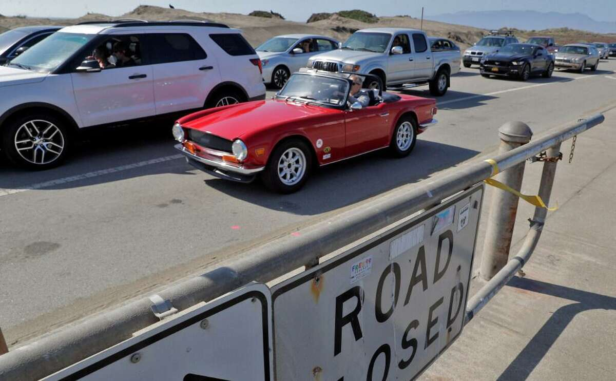 Drivers make their way along the Great Highway, which reopened to car traffic in San Francisco on Monday.