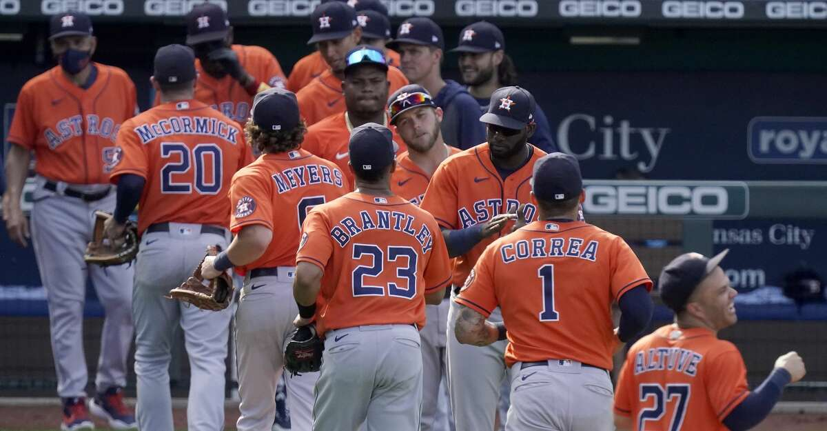 Houston Astros team members celebrate after their baseball game against the Kansas City Royals Thursday, Aug. 19, 2021, in Kansas City, Mo. The Astros won 6-3 in ten innings. (AP Photo/Charlie Riedel)