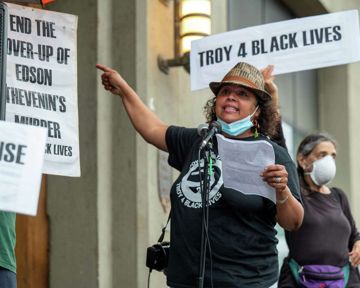 Luz Marquez, of Troy for Black Lives, speaks at a rally in front of Troy City Hall prior to the city Council voting on a court-mediated $1.55 million settlement for the family of Edson Thevenin, a man who was shot and killed by Troy Police Sgt. Randall French during a traffic stop in 2016. (Jim Franco/Special to the Times Union)