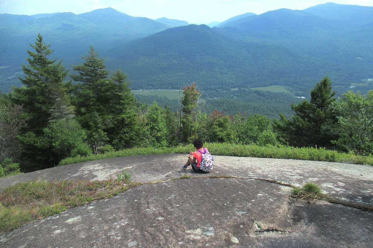 Wren takes in the view from an open spot on Blueberry Mountain in the Adirondack High Peaks.