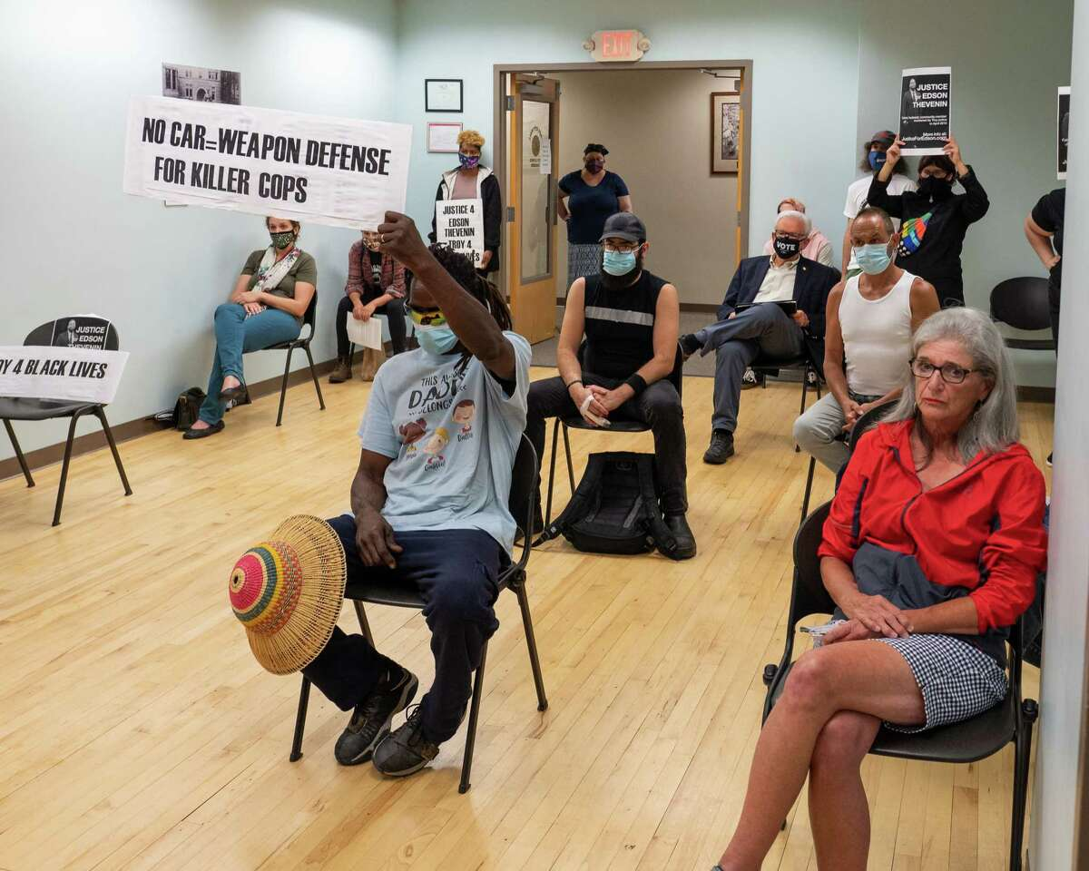 Protesters during a Troy City Council meeting prior to it voting on a court-mediated $1.55 million settlement for the family of Edson Thevenin, a man who was shot and killed by Troy Police Sgt. Randall French during a traffic stop in 2016. (Jim Franco/Special to the Times Union)