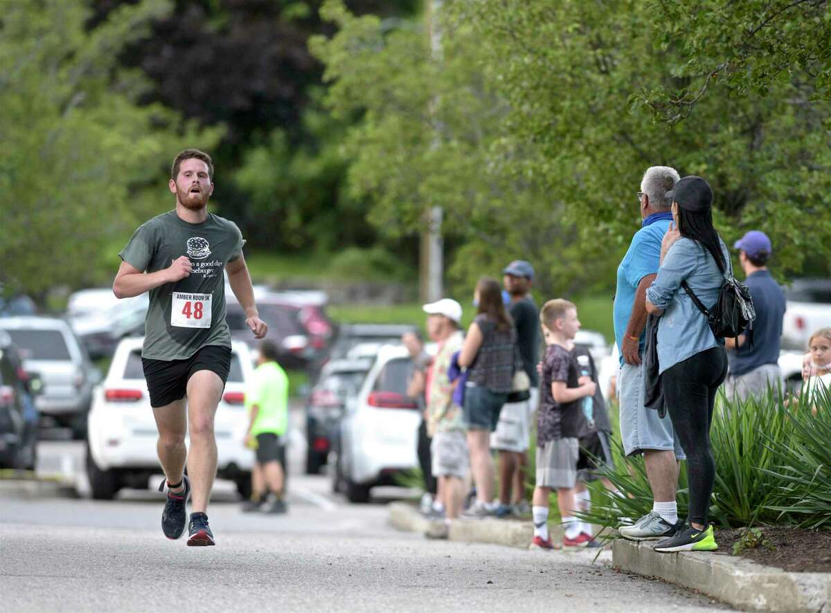 Kevin Michalka, of Bethel, was the first runner to finish the Amber Room Colonnade annual Amber Room Run from the Sun 5K with a time fo 19:55 minutes. The run was to benefit Ann's Place. Thursday, August 19, 2021, in Danbury, Conn.