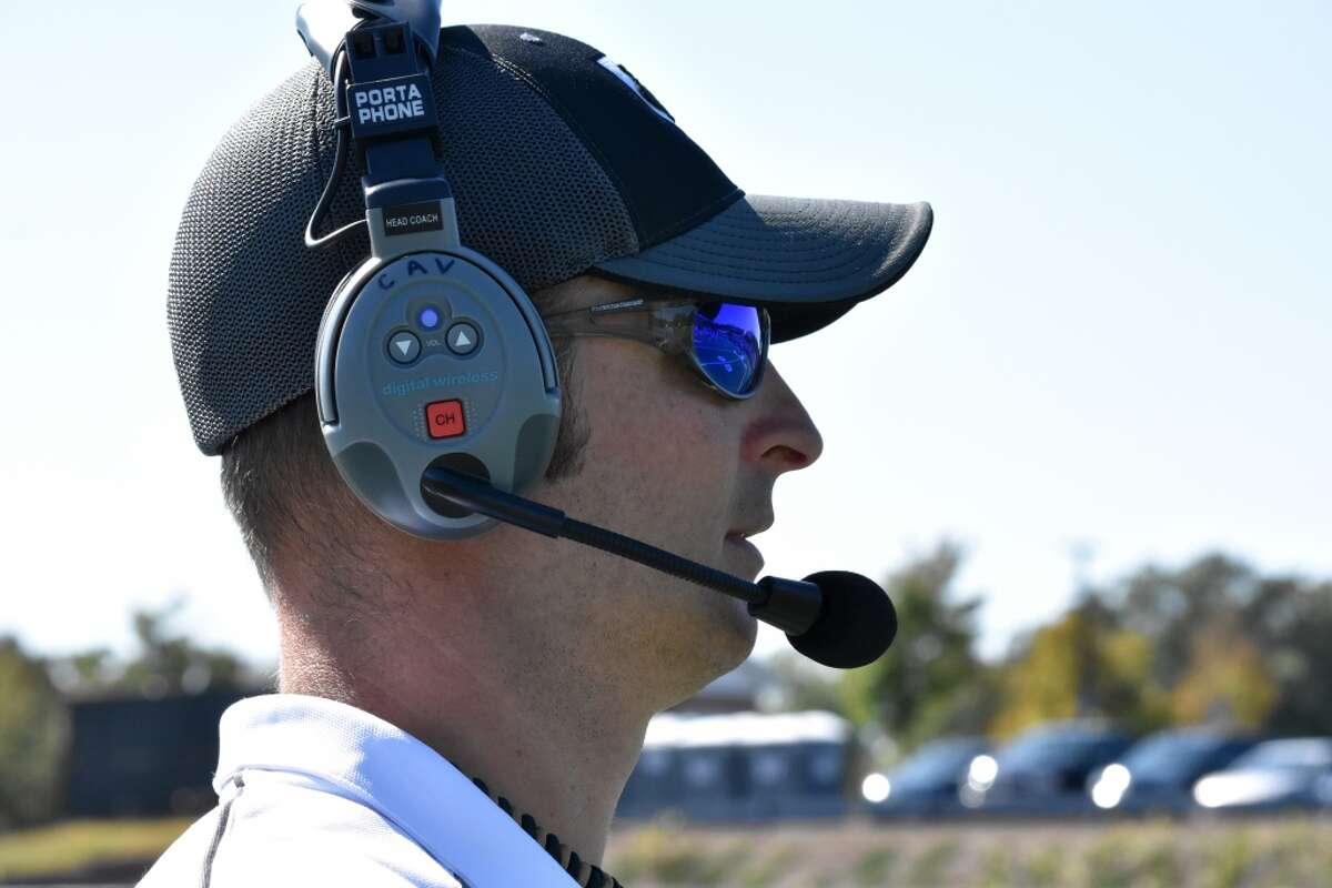 Joel Barlow coach T.J. Cavaliere coaches on the sidelines against Tolland in 2019.