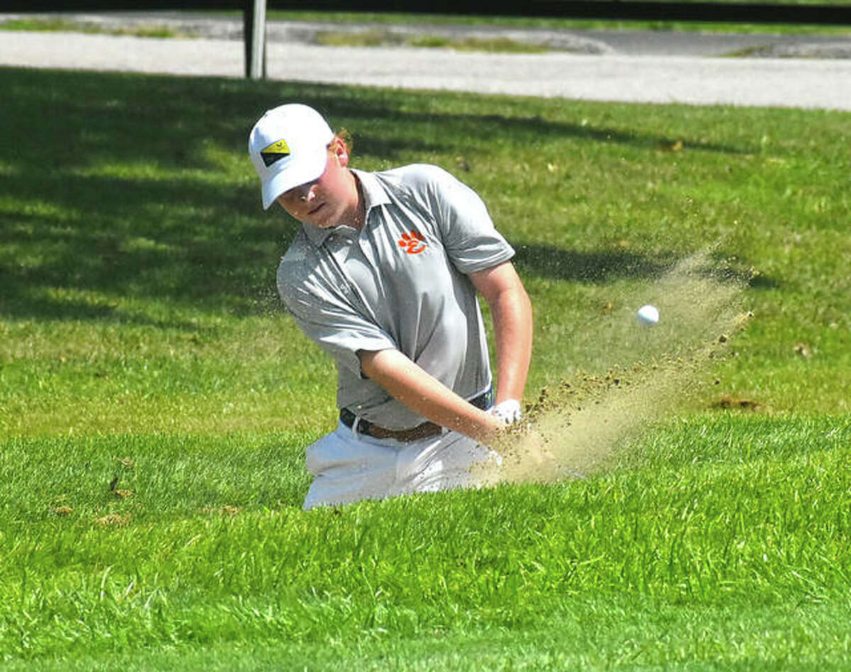Edwardsville's Mason Lewis hits out of the bunker on No. 1 at Belk Park Golf Course during the Madison County Tournament on Thursday in Wood River.