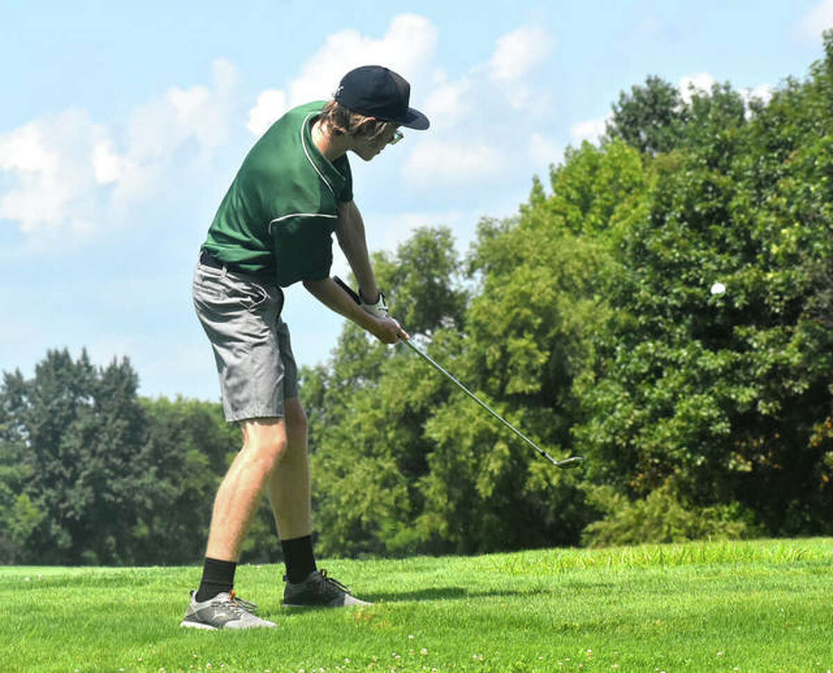 Metro-East Lutheran's Charlie Fedder chips onto the green at No. 7 at Belk Park Golf Course during the Madison County Tournament on Thursday in Wood River.