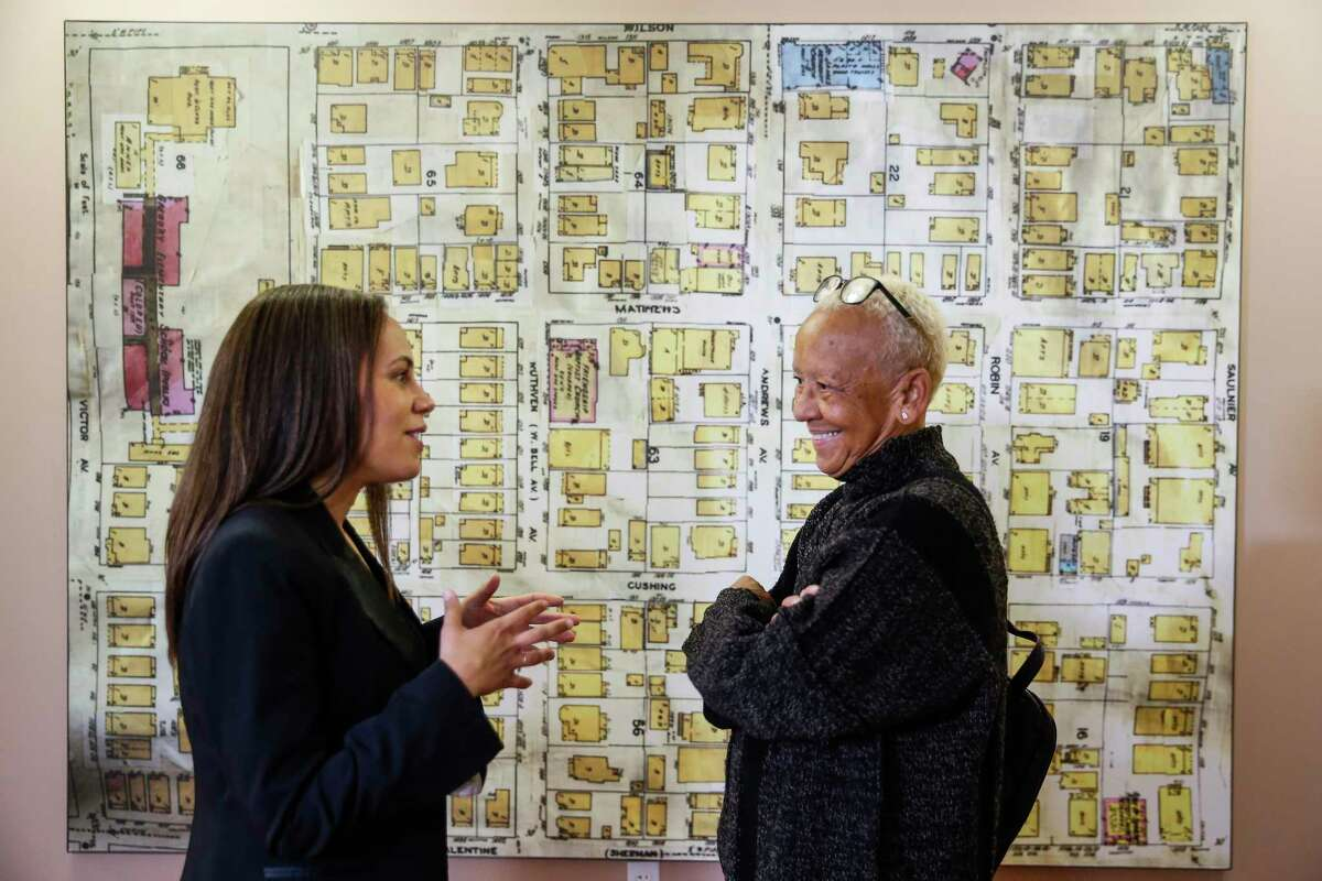 Poet Nikki Giovanni, right, stands in front of a map of Freedmen's Town as she takes a tour of the African American Library at the Gregory School with library manager and curator Danielle Wilson, left, Thursday, Feb. 15, 2018 in Houston. Giovanni will be speaking about her new book, A Good Cry, at the UH Cullen Performance Hall Thursday night. (Michael Ciaglo / Houston Chronicle)