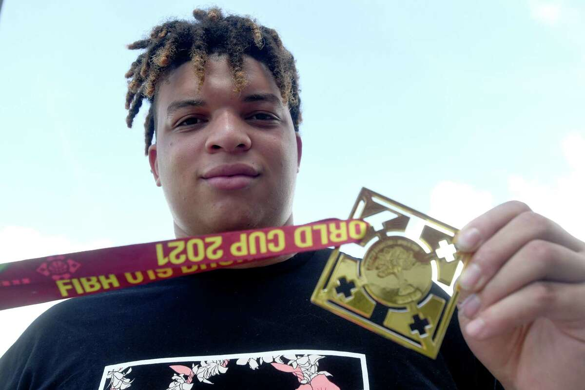 Port Arthur Memorial alumnus and basketball star Kenneth Lofton, Jr., holds up his medal while attending Port Arthur Rotary Club's weekly meeting to receive an honor for his role in the FIBA team USA championship. Photo made Thursday, August 19, 2021 Kim Brent/The Enterprise