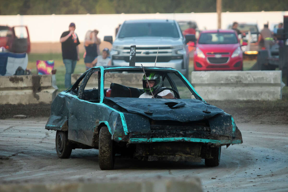 Drivers compete in a figure 8 derby Thursday, Aug. 19, 2021 at the Midland County Fairgrounds. (Katy Kildee/kkildee@mdn.net)
