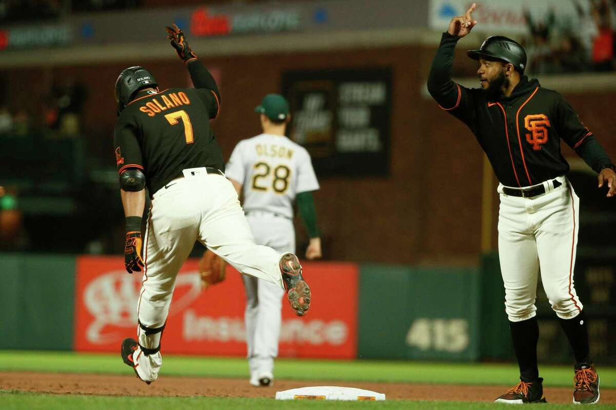 Donovan Solano, first-base coach Antoan Richardson and the Giants take on Matt Olson and the A's in the opener of a three-game series at the Coliseum at 6:30 p.m. Friday (Channel 11, NBCSCA/104.5, 680, 960).