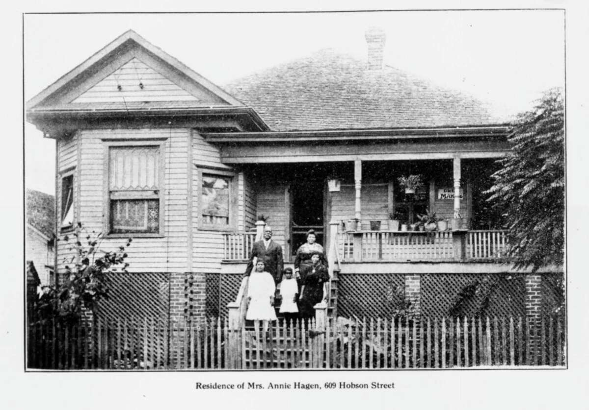 Annie Hagen, shown with family members on the steps of her circa 1908 home at 609 Hobson St., was a much-respected nurse and midwife.