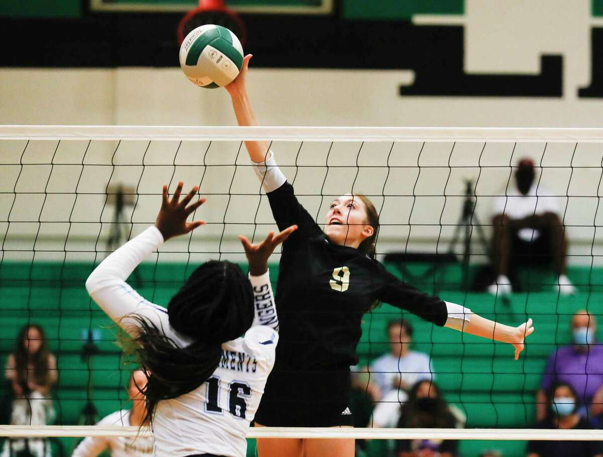 Montgomery middle blocker Taryn McAnally (9) tips the ball over Clements middle blocker Elizabeth Onyekwere (16) in the first set of a high school volleyball match during the Spring ISD Tournament at Spring High School, Thursday, Aug. 19, 2021, in Spring.