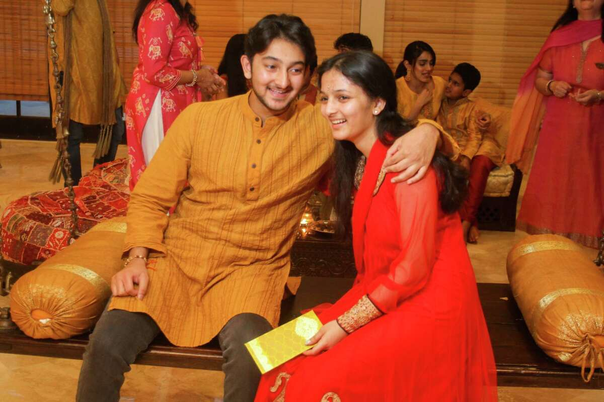 Akash Shah, left, and his sister, Kajal Shah celebrate Raksha Bandhan, also abbreviated to Rakhi, the Hindu festival that celebrates brotherhood and love.Traditionally, during the festival sisters tie a rakhi, a bracelet made of interwoven red and gold threads, around their brothers' wrists to celebrate their relationship.