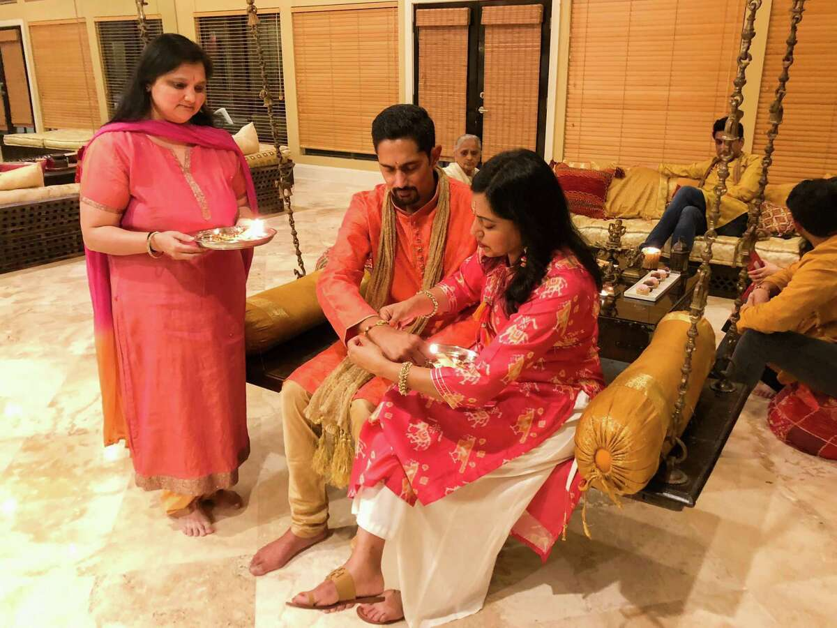 Sonal Shah, from left, Samir Sanghani and Sandhya Thakkar celebrate Raksha Bandhan, also abbreviated to Rakhi, the Hindu festival that celebrates brotherhood and love. Traditionally, during the festival sisters tie a rakhi, a bracelet made of interwoven red and gold threads, around their brothers' wrists to celebrate their relationship. Sonal and Sandhya are sisters, and Samir is their brother.