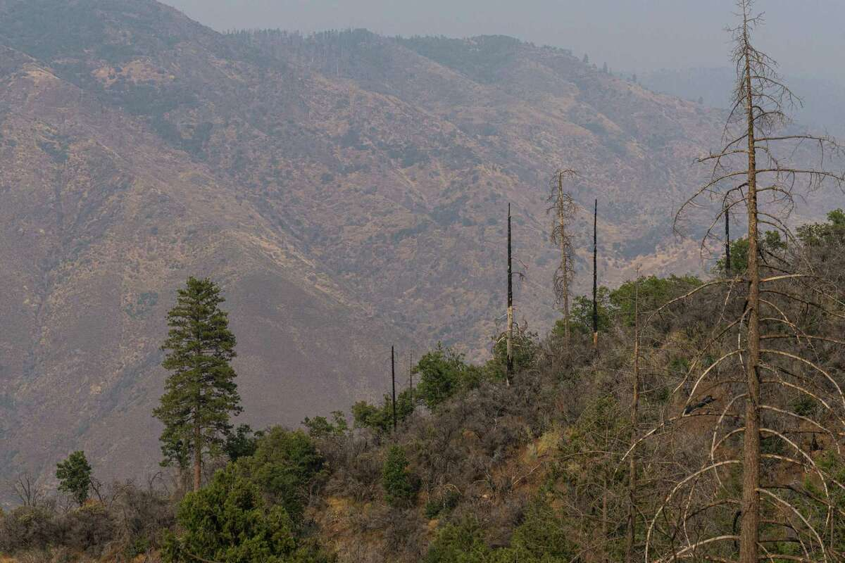 The Hite Cove Trail offers spectacular views, albeit smoky on Thursday.