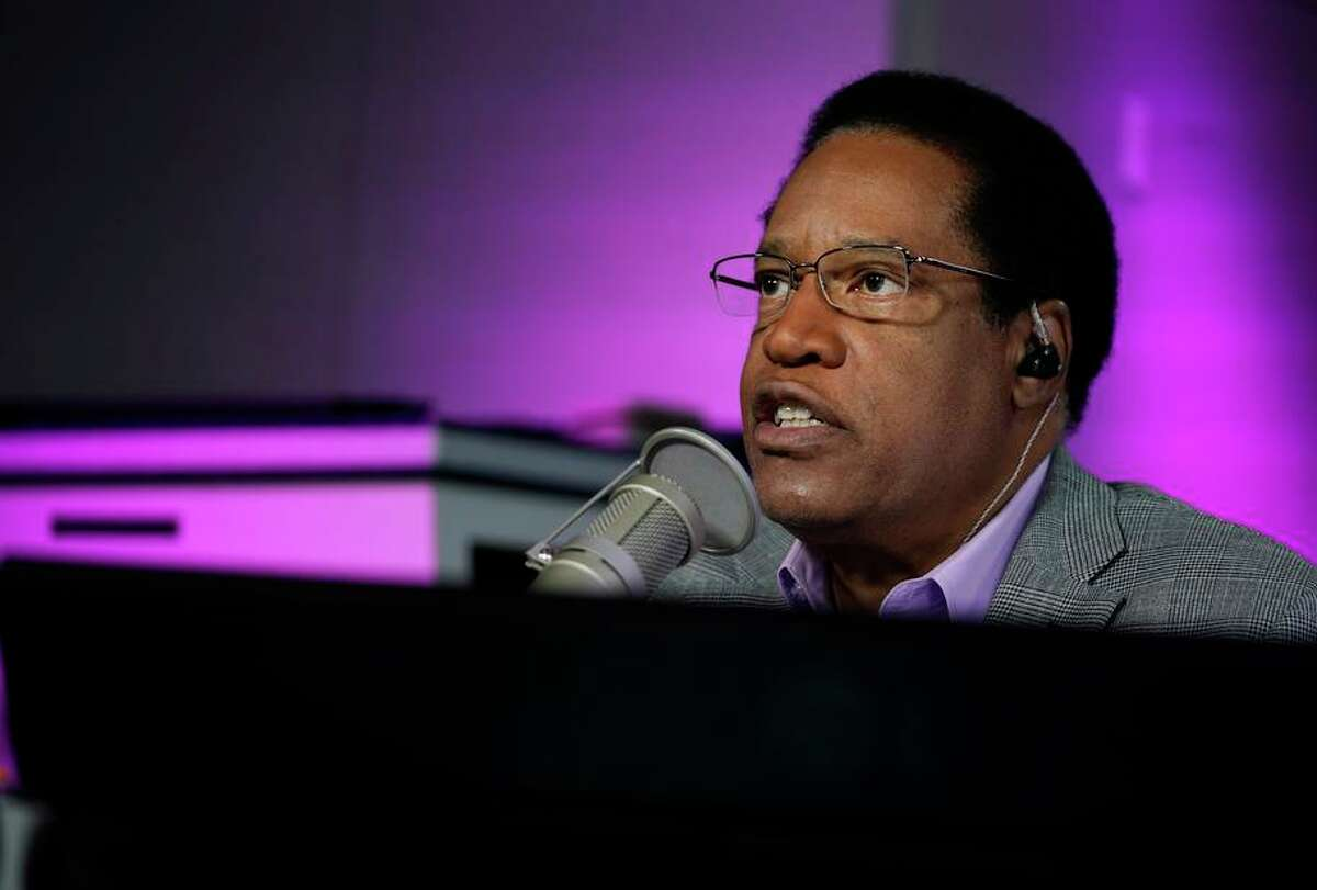FILE - In this July 12, 2021 file photo radio talk show host Larry Elder speaks during his show, in Burbank, Calif. Alexandra Datig, Elder's former fiancee said Thursday, Aug. 19 that Elder, a candidate for governor in the Sept. 14 recall election, once displayed a gun to her during a heated argument in 2015. Elder said he never brandished a gun at anyone. (AP Photo/Marcio Jose Sanchez, File)