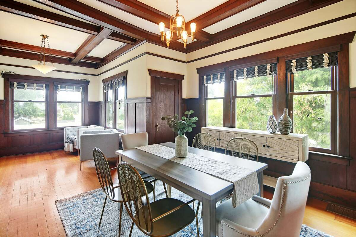 The formal dining room is surrounded by windows.