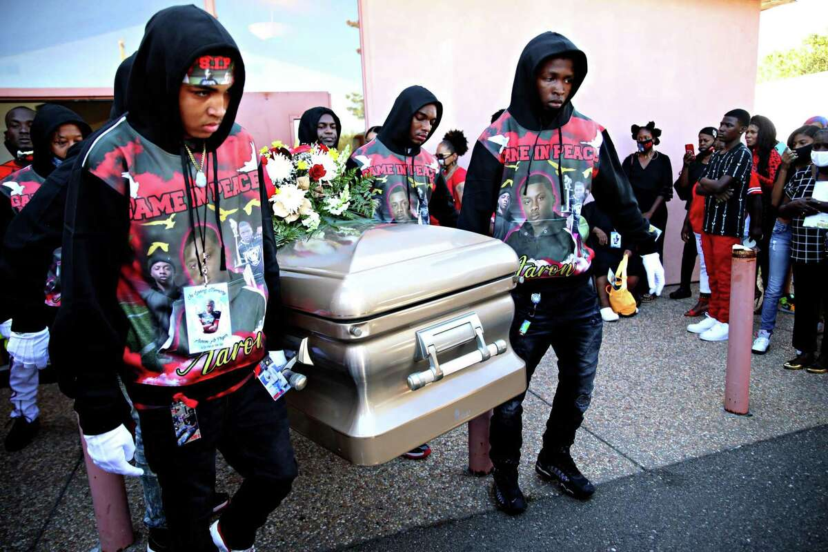 Pallbearers exit B.A.S.I.C. Ministry Church with the casket of Aaron Pryor following his funeral service on Saturday, October 17, 2020, in San Leandro, Calif. Pryor was slain on September 27, only a few weeks after he turned 16 in Oakland. Pryor was a star running back for Skyline High School.