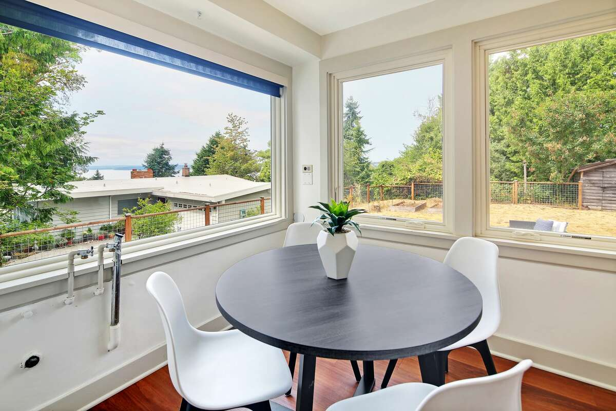 A breakfast nook in the kitchen overlooks the water view.