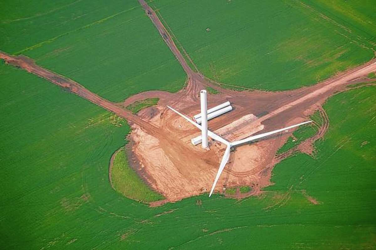 An aerial view shows a wind turbine awaiting completion in Morgan County. All 107 wind turbines in the area are on schedule to be operational by November.